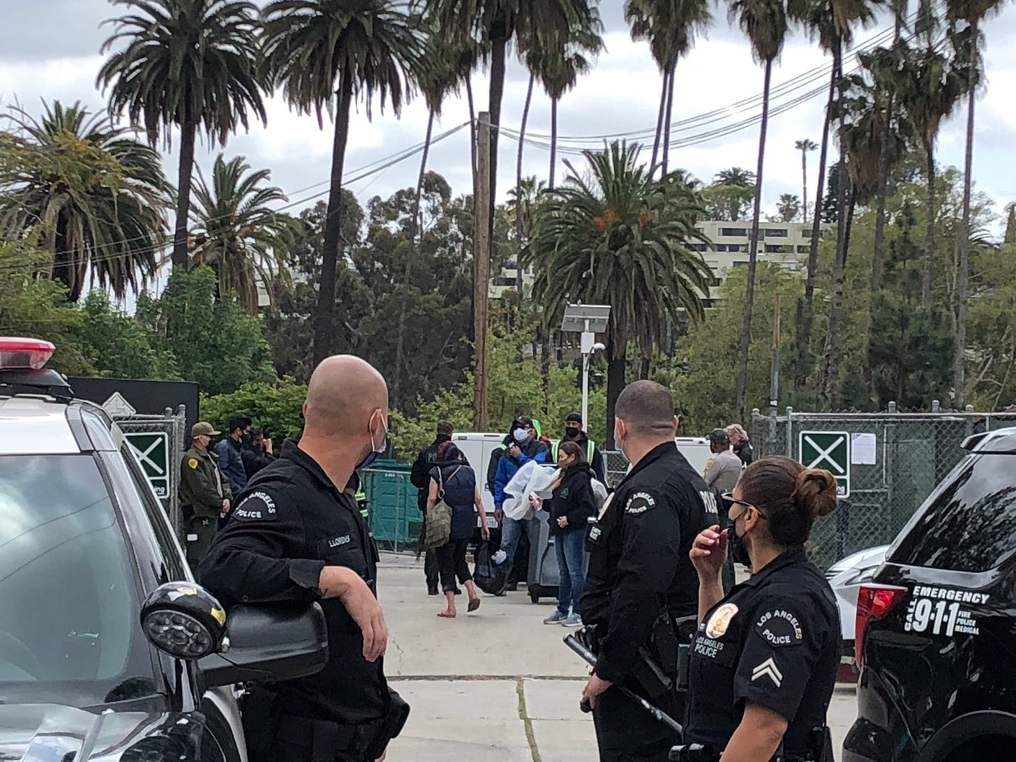 Police watch on as Susan is escorted out of the park on Thursday.
