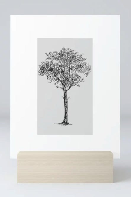 photo of Strong and Rooted art on a mini art print with wooden stand. A hand-drawn pen illustration of a tree on a white card.