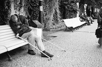 May be a black-and-white image of one or more people, people sitting and outdoors