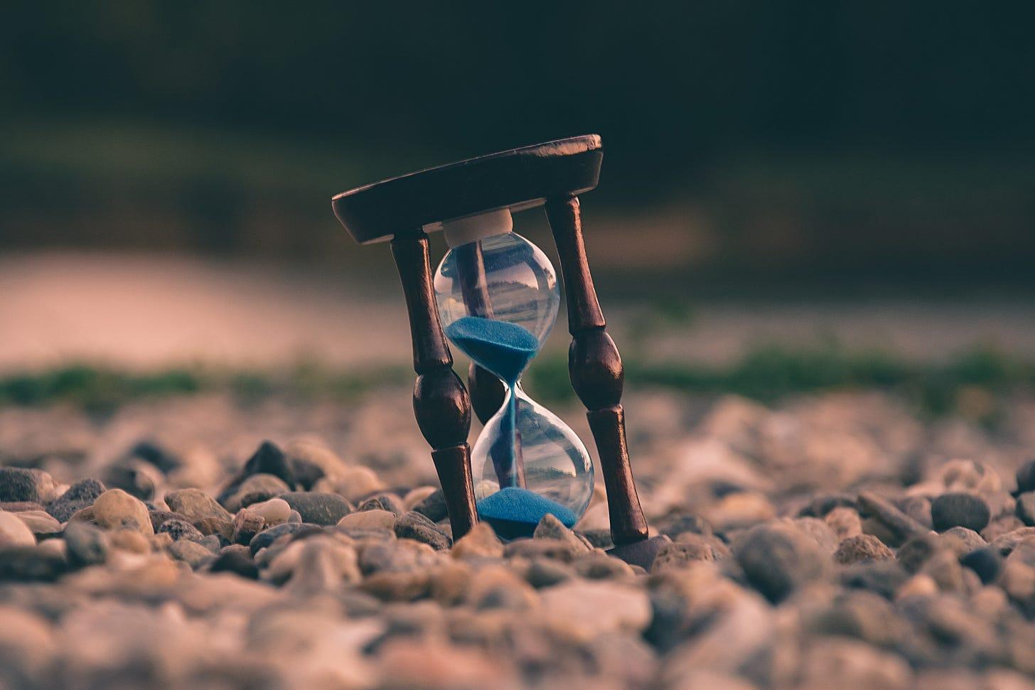 Hour glass on a beach