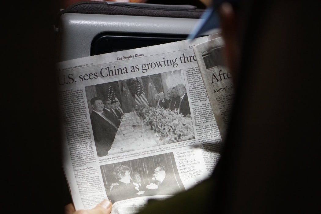 Person holds Los Angeles Times newspaper from December 31, 2018. Headline reads: 'U.S. sees China as growing threat'.