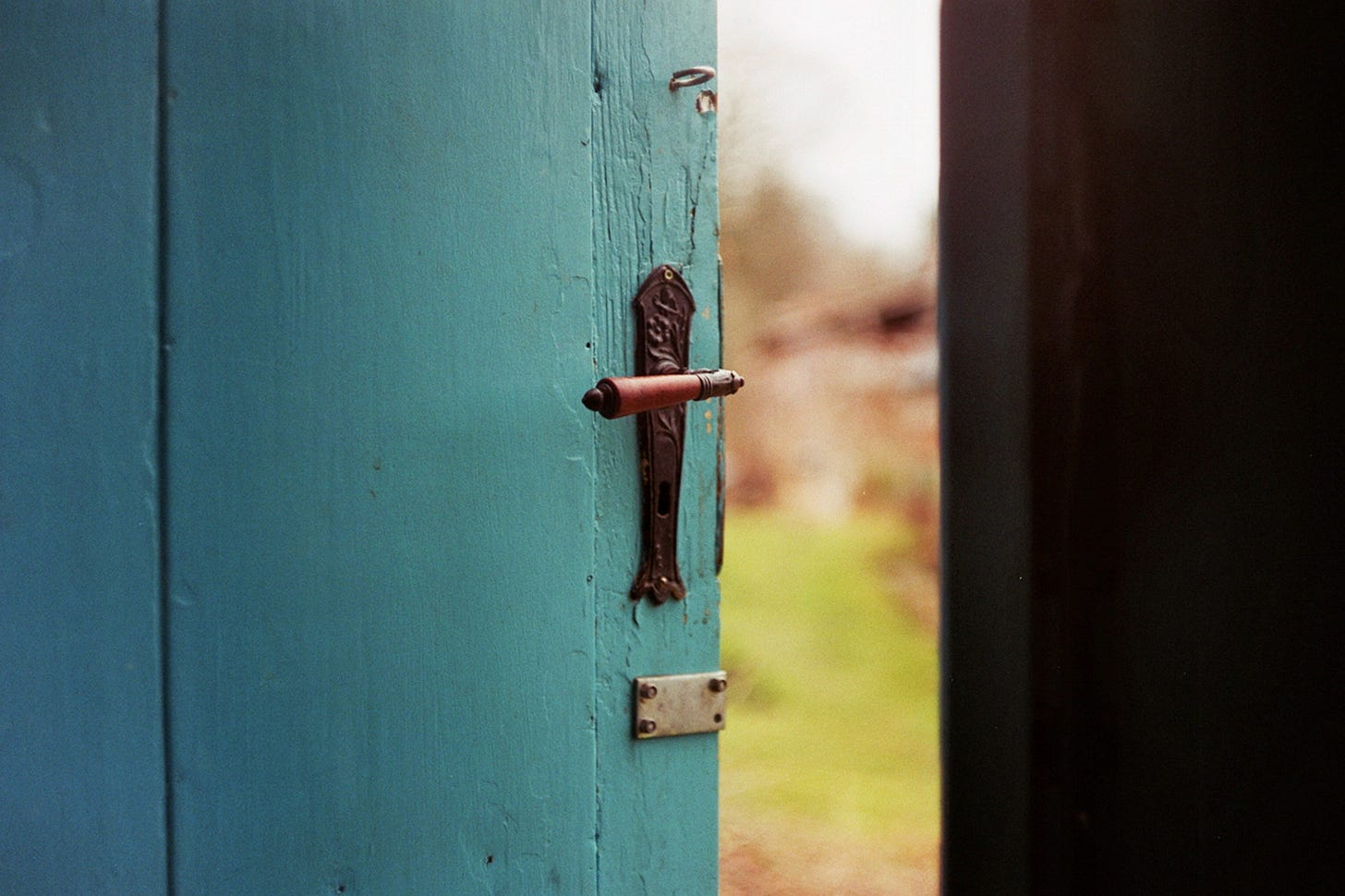 Image of an open door to the outside for article by Larry G. Maguire