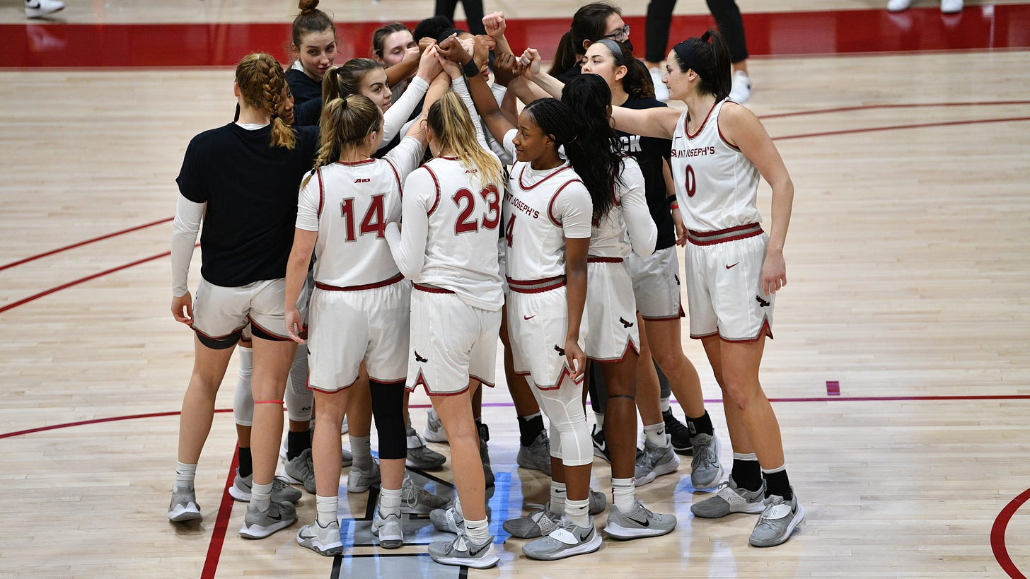 Saint Joseph's women's basketball huddles up during a game. Photo Credit: Sideline Photos, LLC.