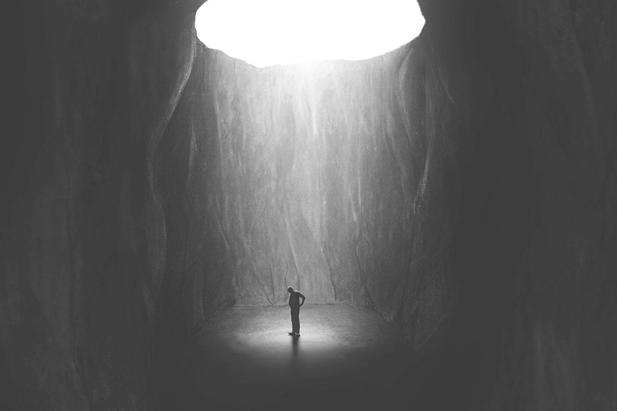 Figure Stuck in Dungeon with Light Above