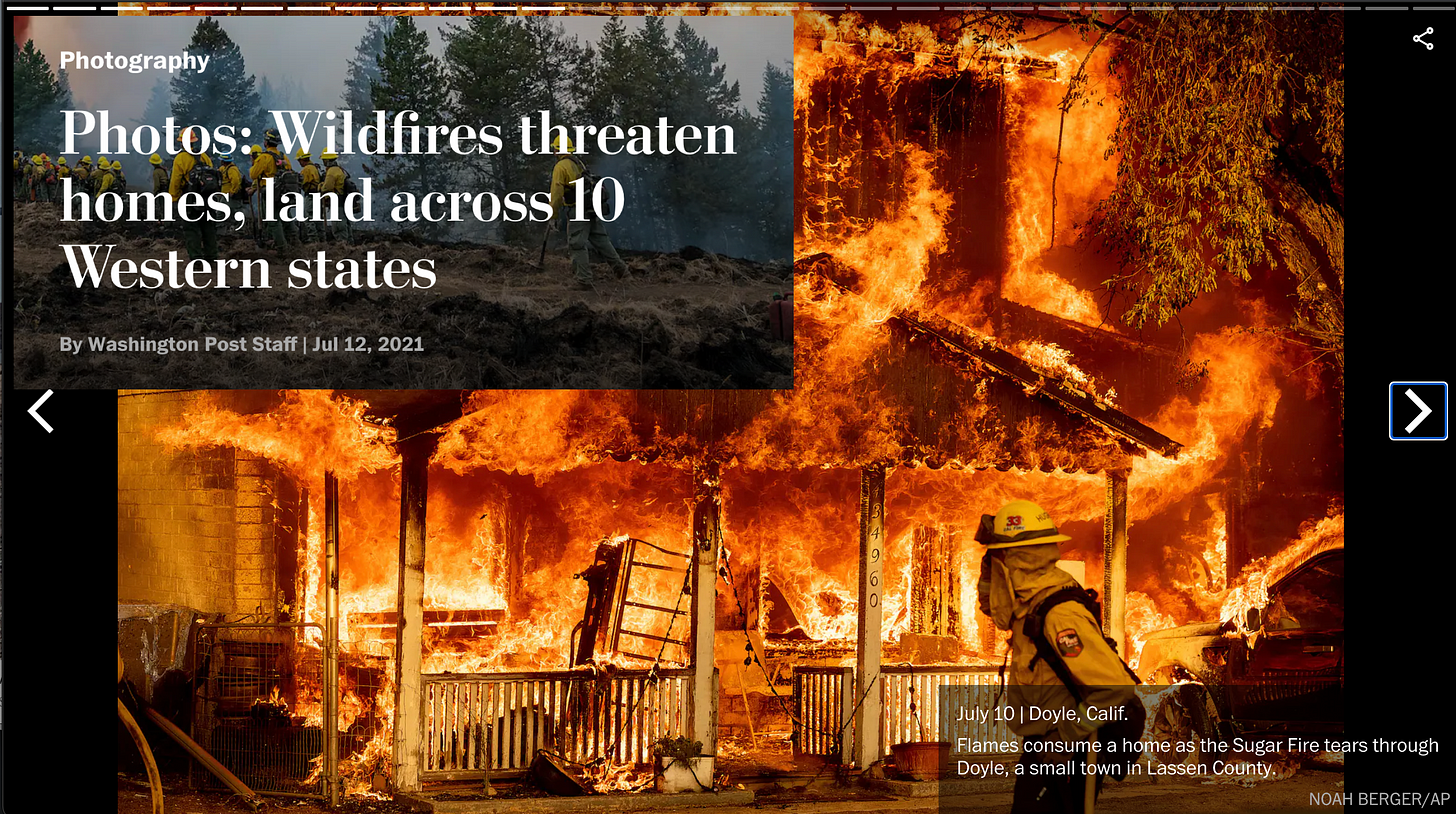 """Photo from the Washington Post via AP photographer Noah Berger of a home completely engulfed in flames in Doyle, California. From the gallery """"Wildfires threaten homes, land across 10 western states"""""""