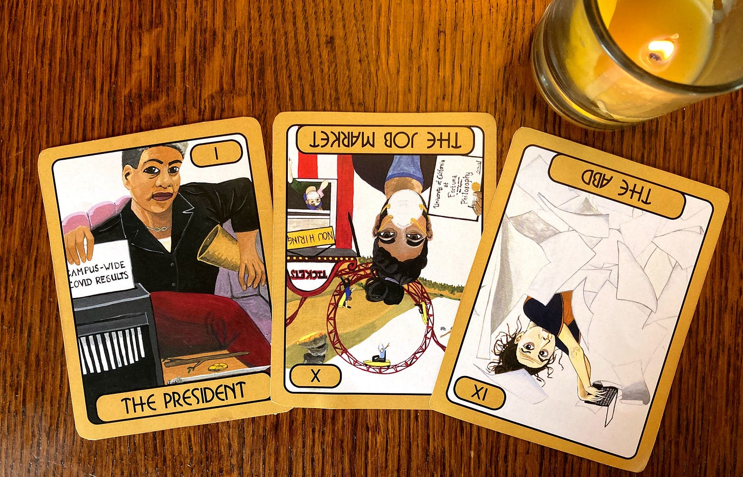 Three tarot cards on a wooden table with a candle. The President shows a woman on a purple couch shredding campus covid test results; the job market reversed shows a man wearing a mask in front of a roller coaster; and the abd shows a woman typing on a laptop surrounded by papers.