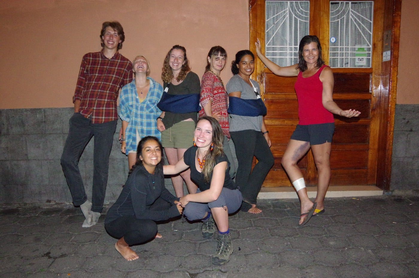 In Quito outside our hostel, 4 days after the accident. Clockwise from left: Rowan, Rachel, Lily, Kirstin, Odette, Heather, Dorrie, Val. Photo by Bret.