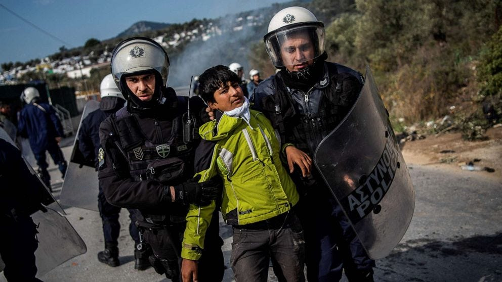 PHOTO: Riot police detain a migrant during clashes near the Moria camp for refugees and migrants, on the island of Lesbos, March 2, 2020.