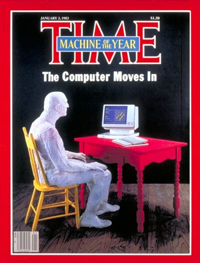 "Cover of Time Magazine. Man sitting at a desk looking at a computer. Headline ""The Computer Moves In"""