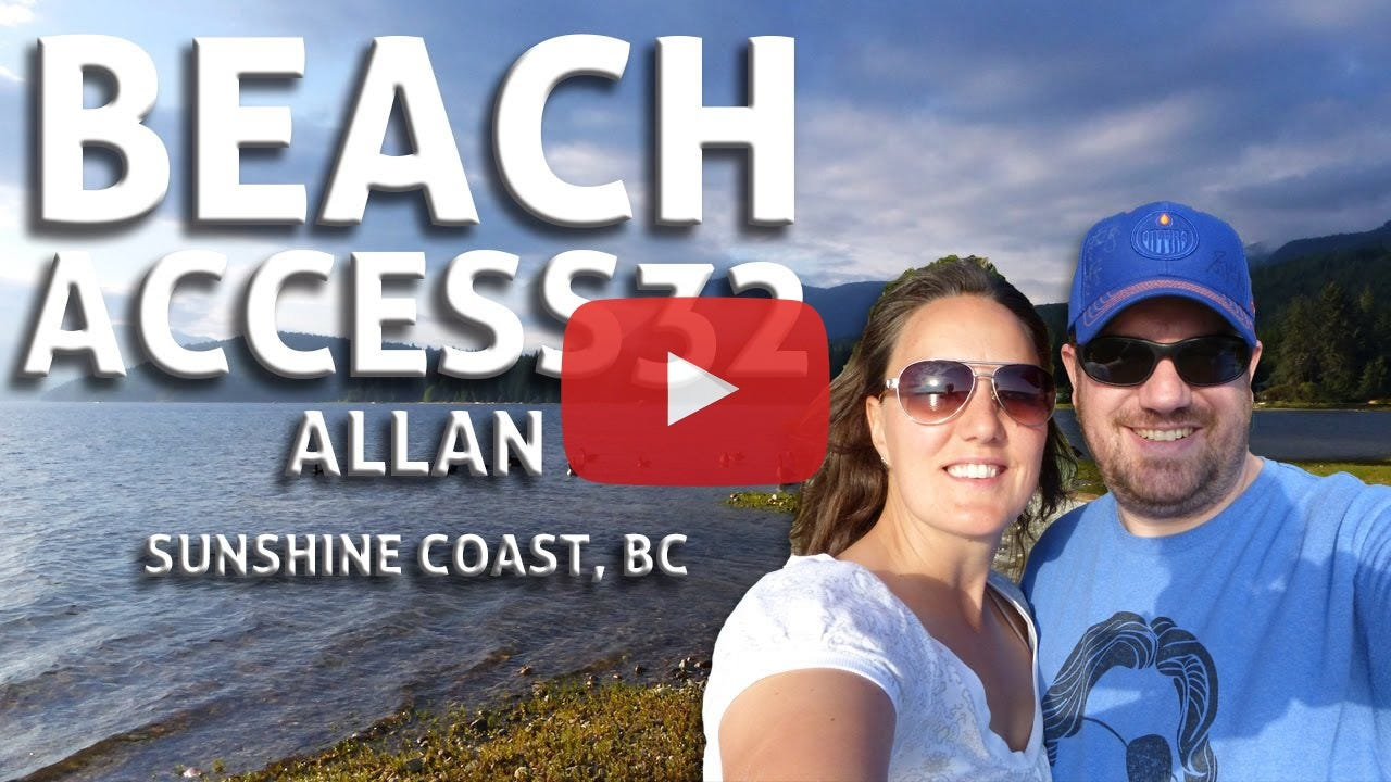 An extremely attractive couple stands on a beach along Sechelt Inlet.