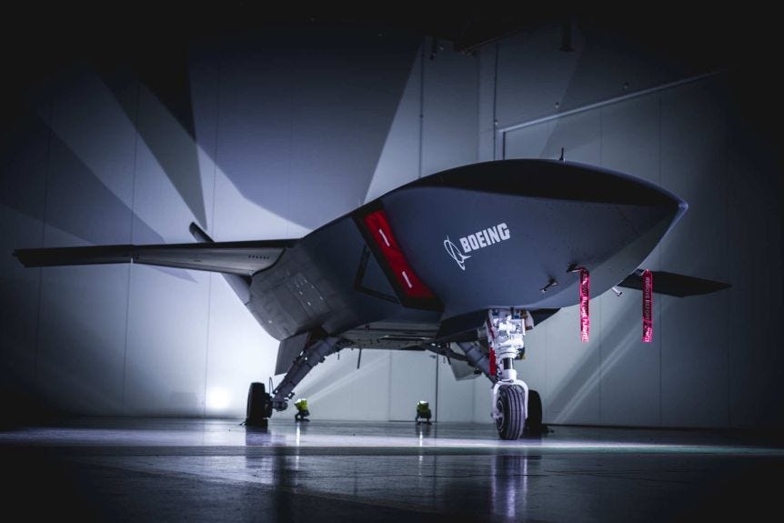 A large jet-like drone in a hangar.