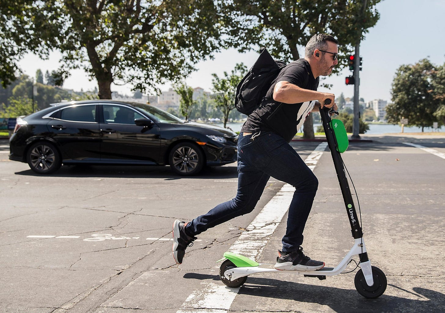 Image result for scooter next to car