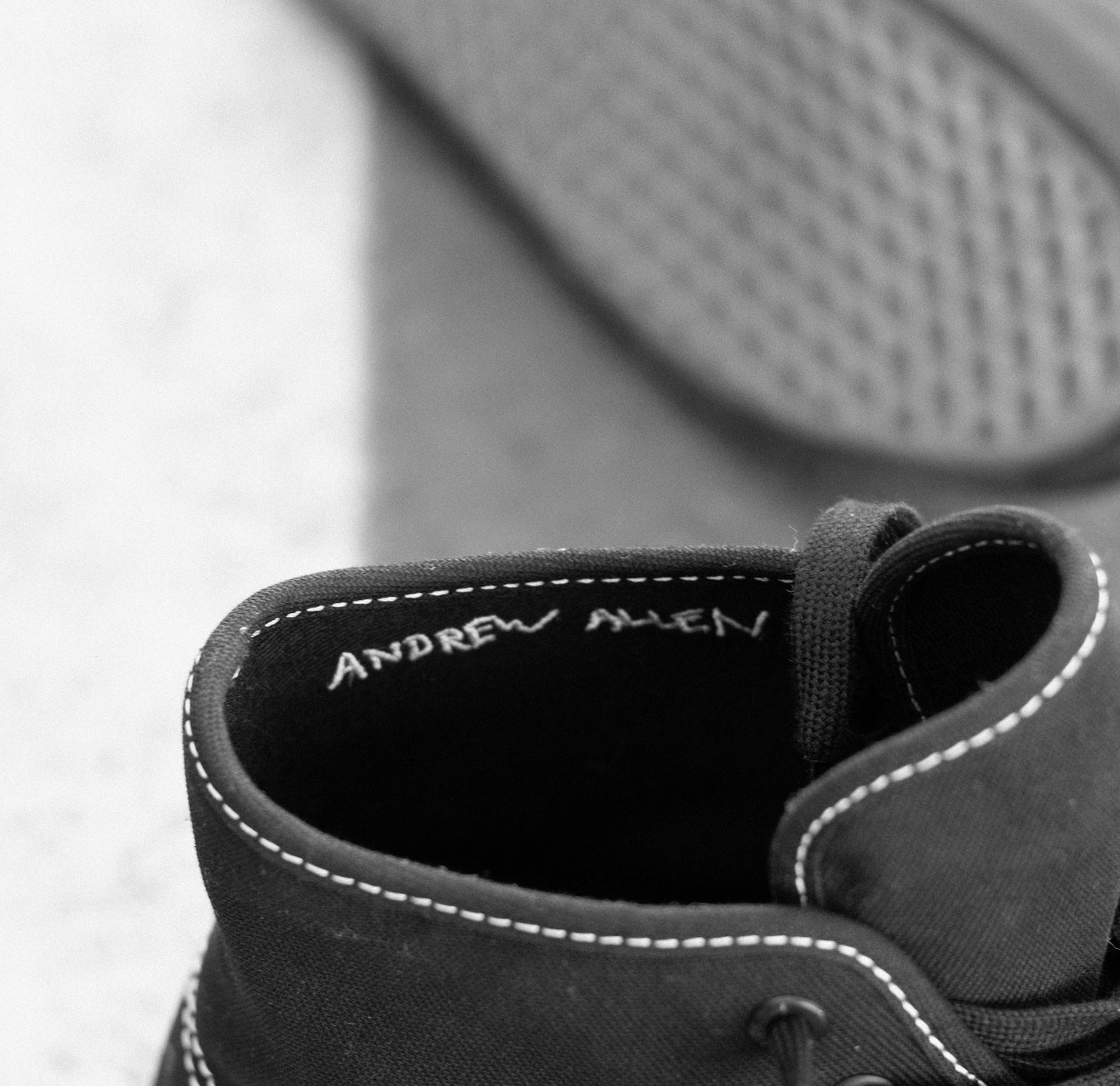 A pair of black shoes  Description automatically generated