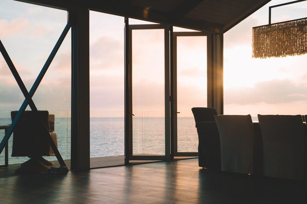 white wooden framed glass window beside blue sea