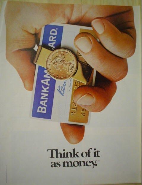 """""""pense nisso como dinheiro"""", propaganda da visa onde uma mão segura um cartão e uma moeda"""