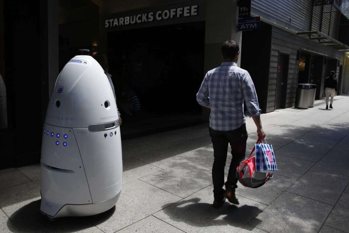 A Knightscope K5 autonomous security robot roams around the Stanford Shopping Center on June 15, 2016 in Palo Alto, Calif.
