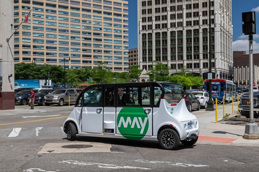 A self-driving shuttle from May Mobility transports commuters in downtown Detroit.