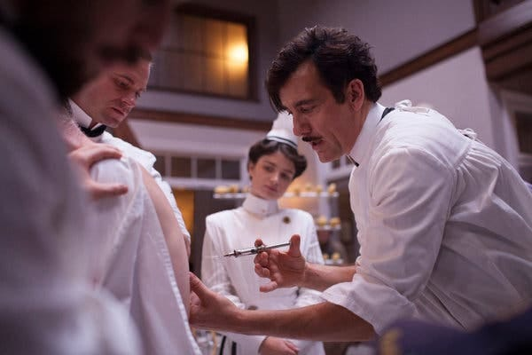 """Clive Owen wields a needle as Eric Johnson and Eve Hewson watch in a scene from """"The Knick."""""""