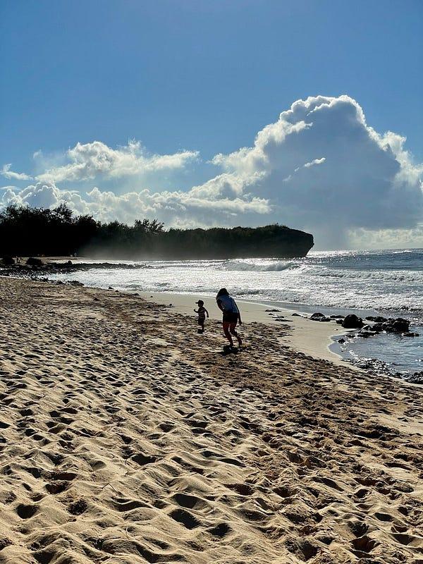 Remote work in Hawaii (running on Shipwreck Beach)