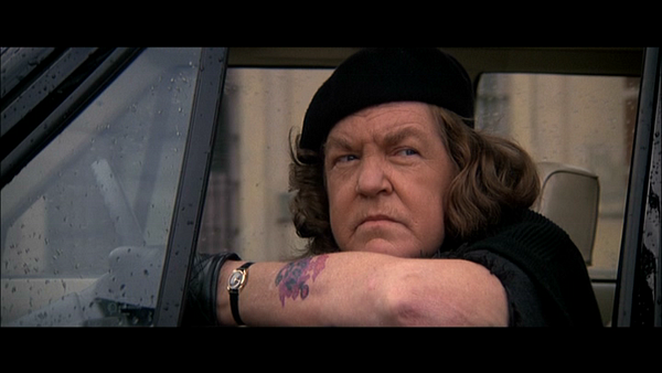 Ma Fratelli wearing her beret and driving gloves in a car