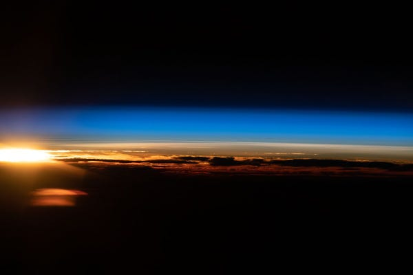 An orbital sunrise is pictured from the International Space Station as it soared 265 miles above the Indian Ocean off the coast of Western Australia.