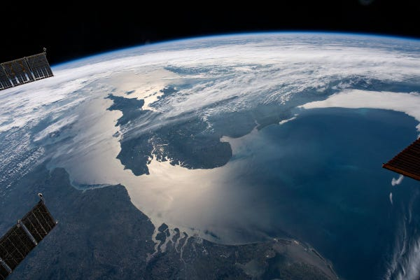 The sun's glint beams across the English Channel and the North Sea in between southern England and the coasts of France, Belgium and The Netherlands, in this photograph from the International Space Station as it orbited 263 miles above.