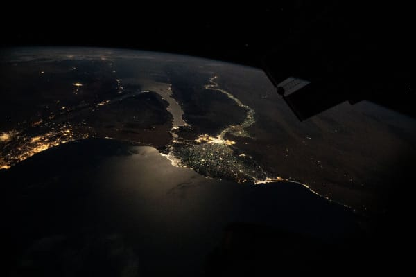 This nighttime photograph, taken from the International Space Station as it orbited 263 miles above Turkey, highlights the Moon's glint on the Mediterranean Sea and the Gulf of Suez. The city lights along the Nile Delta and the eastern Mediterranean coast also figure prominently in the picture.