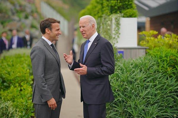 President Biden talks with President Macron