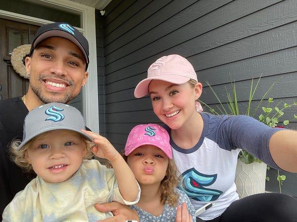 Seattle Kraken new TV Color Analyst taking a selfie with his wife & two kids in Kraken gear