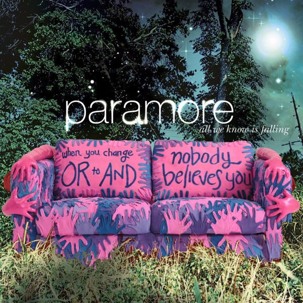 """The cover of all we know is falling by paramore with a couch in a grassy field except the couch is the bisexual pride flag cough from ikea thats covered in hands & the words """"when you change or to & nobody believes you"""""""