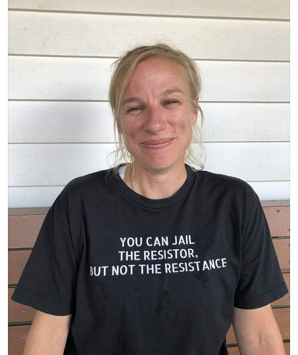 """A photo of Jessica smiling. Her shirt reads """"You can jail the resistor, but not the resistance""""."""