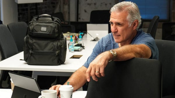 Solo shot of Seattle Kraken GM, Ron Francis in the war room with a laptop