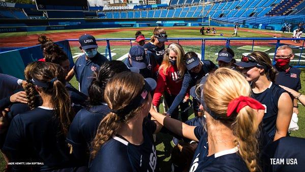 U.S. Olympic softball team in a huddle