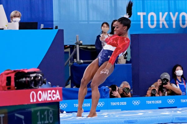 Simone Biles lands awkwardly while competing on the vault.