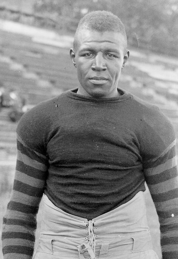 Duke Slater poses for a portrait wearing his football gear.