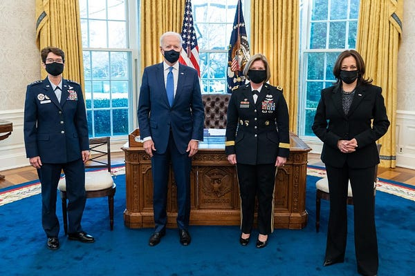President Biden poses for a photo with Vice President Kamala Harris, General Jacqueline Van Ovost, and Lieutenant General Laura Richardson in the Oval Office