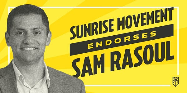 """graphic with yellow sun rays in the background. on the left is a black and white picture of a man smiling staring at the camera wearing a suit jacket and white shirt. He has short hair. To the right in dark grey slanted text it states """" Sunrise movement endorses Sam Rasoul"""""""