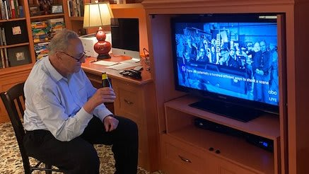 Senator Schumer watches the Oscars with an ice cold plant-based beer, April 25, 2021.
